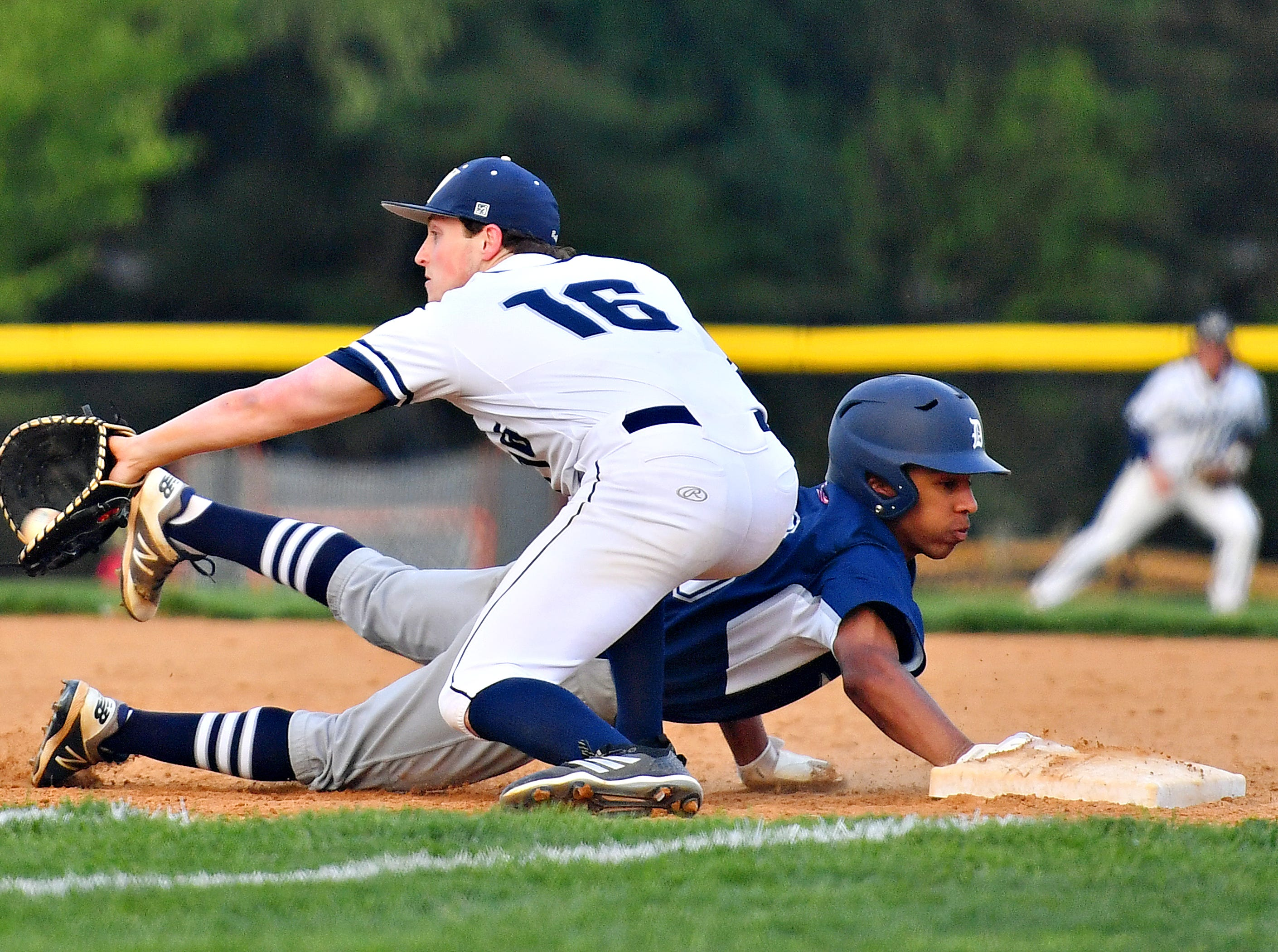 West York's Gabe Allen, front, looks for the ball in an attempt to pick off Dallastown's Andrew Jones during baseball semifinal action at Spring Grove Area High School in Jackson Township, Wednesday, May 15, 2019. Dallastown would win the game 12-0. Dawn J. Sagert photo