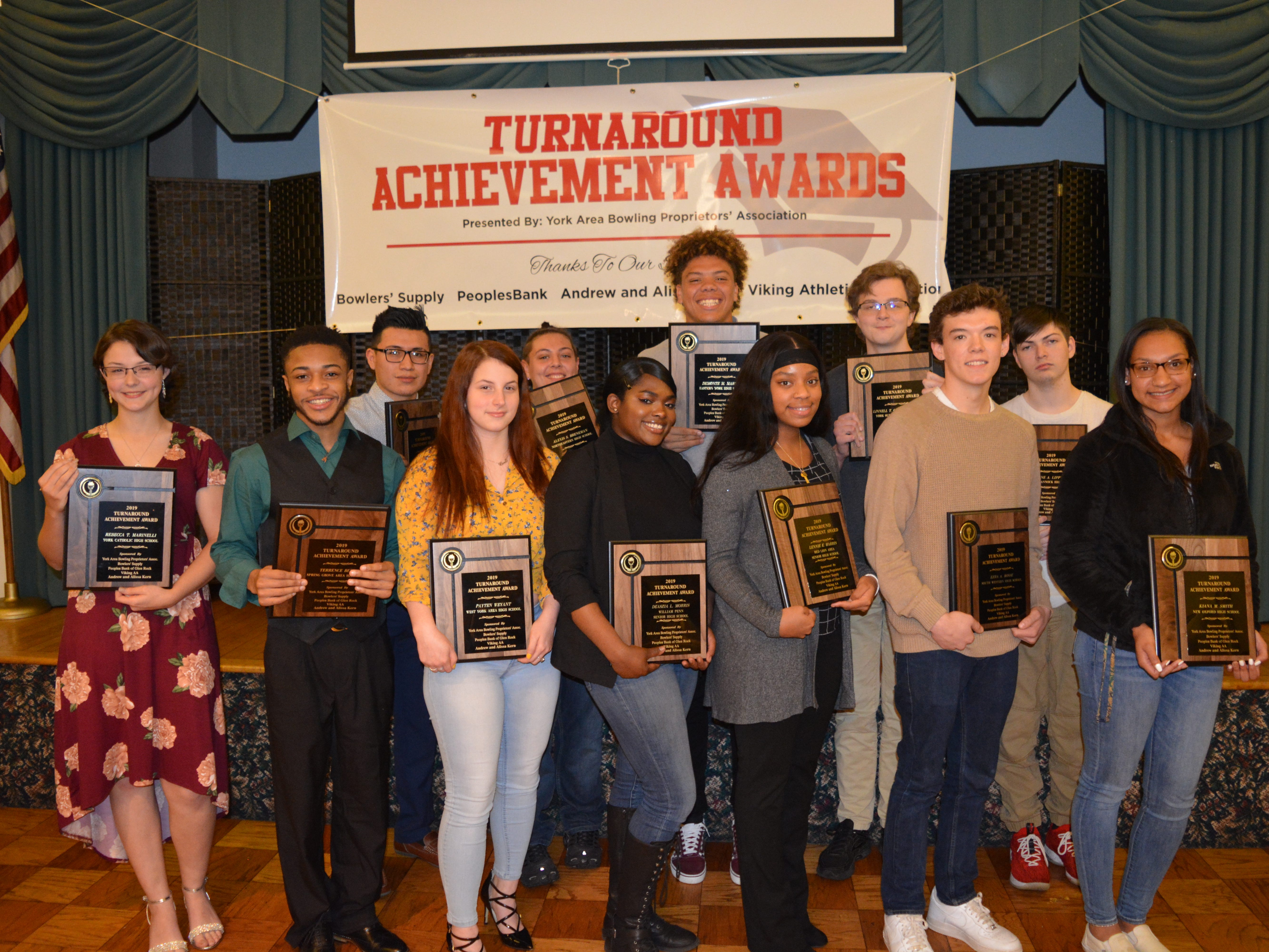 The York Area Bowling Proprietors Association recently honored 15 area high school students with Turnaround Achievement Awards.  The awards recognized students who have turned their lives around through exceptional effort, perseverance and commitment.  Students receiving awards were, front row, left to right, Rebecca Martinelli of York Catholic, Terrence Berry of Spring Grove, Payten Weyant of West York, Deaszia Morris of William Penn, Lennie Harris of Red Lion, Ezra Bosse of South Western and Kiana Smith of New Oxford.  Back row, left to right, Aldo Mendez of Hanover, Alexis Breneman of Northeastern, Damonte Martin of Eastern York, Linnell Gifford-Mahany of York Suburban and Wayne Lippy Jr. of Susquehannock.  Absent when the photo was taken were Joshua Kehr of Littlestown, Jazmin Mann of Dallastown and McKenzie Lincoln of Central York.  The York Area Bowling Proprietors Association also distributed $6,000 in scholarships. submitted