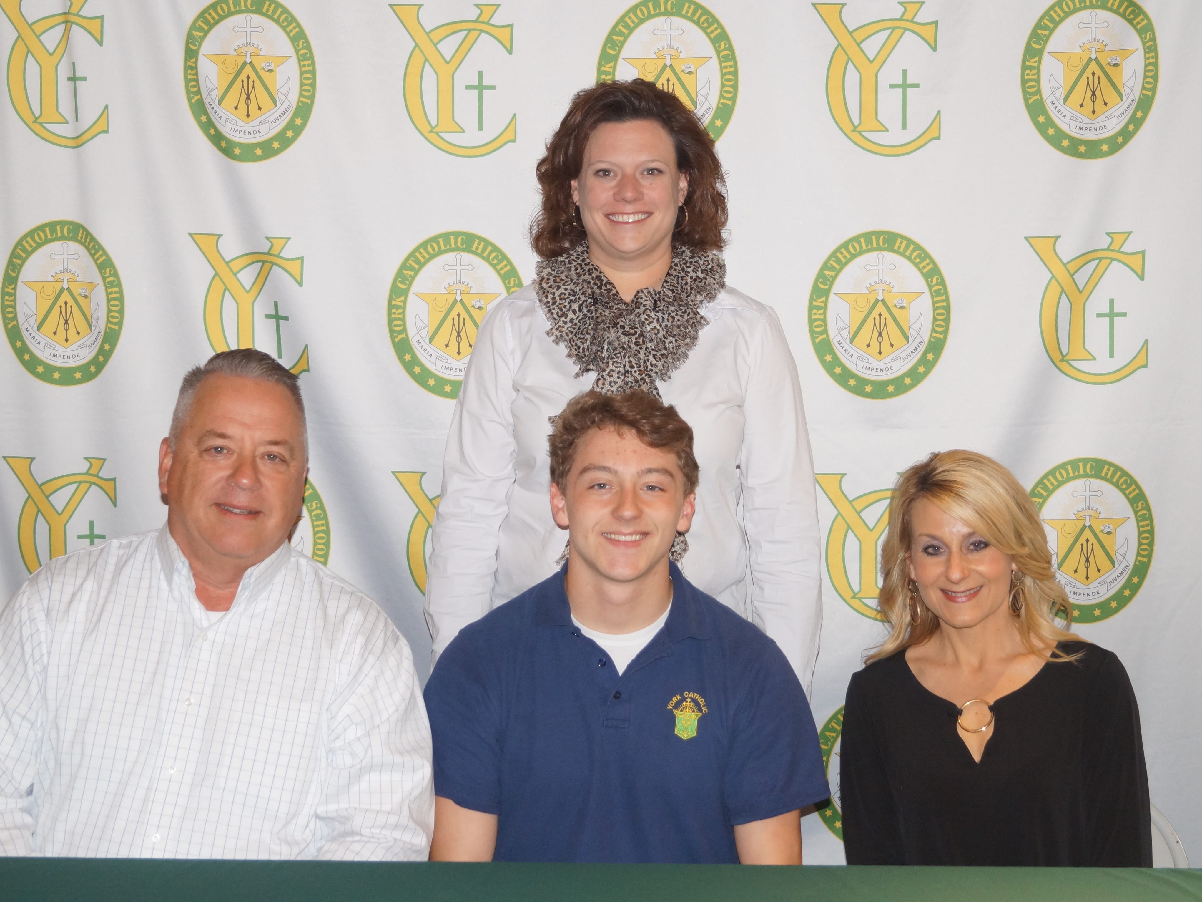 York Catholic High SchoolÕs Chandler Hake has committed to the United States Army Reserve Officer Training Corps (ROTC) while continuing his education at Florida Institute of Technology in Melbourne, Florida. Hake was a 3-year Varsity starter for the Fighting Irish lacrosse team and was a member of the 2016 and 2018 YAIAA Lacrosse Championship teams.  He was named YAIAA Coaches All-Star Second Team Attack in 2018.  He also played basketball and ran cross country while at York Catholic and was a member of the 2018 District III-AA Football Championship team.  Pictured are, front row from left: Steven Hake, father of Chandler; Chandler Hake; Lisa Hake, mother of Chandler.  Back Row:  Katie Seufert, York Catholic Principal. submitted