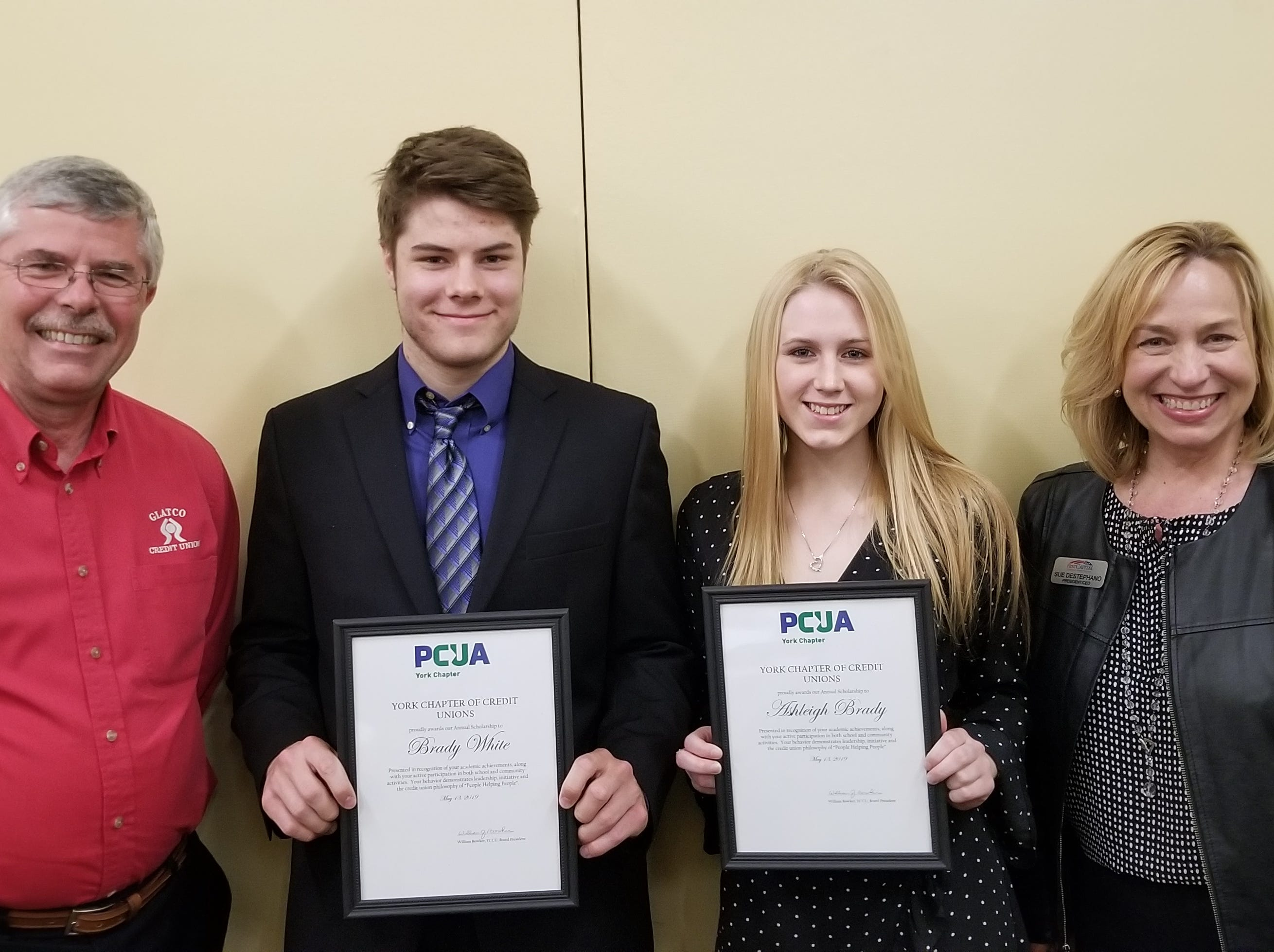 On Monday, May 13, 2019, the York Chapter of Credit Unions announced the winners of its 2019 scholarship contest; Brady White and Ashleigh Brady.  Both received $1,000 to go towards their first year of schooling. Pictured, from left, are Bill Bowker, President/CEO Glatco Credit Union & Chapter President; Brady White, West York Area High School senior; Ashleigh Brady, Dallastown Area High School senior, and Sue DeStephano, President/CEO, First Capital Federal Credit Union. submitted