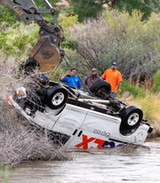 Workers recover a FedEx delivery van which crashed into the Walker River at Nordyke Road south of Yerington Tuesday afternoon.
