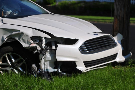 The front of a Ford Fusion sustained damage Wednesday, May 15, 2019, during an accident on South E Street.