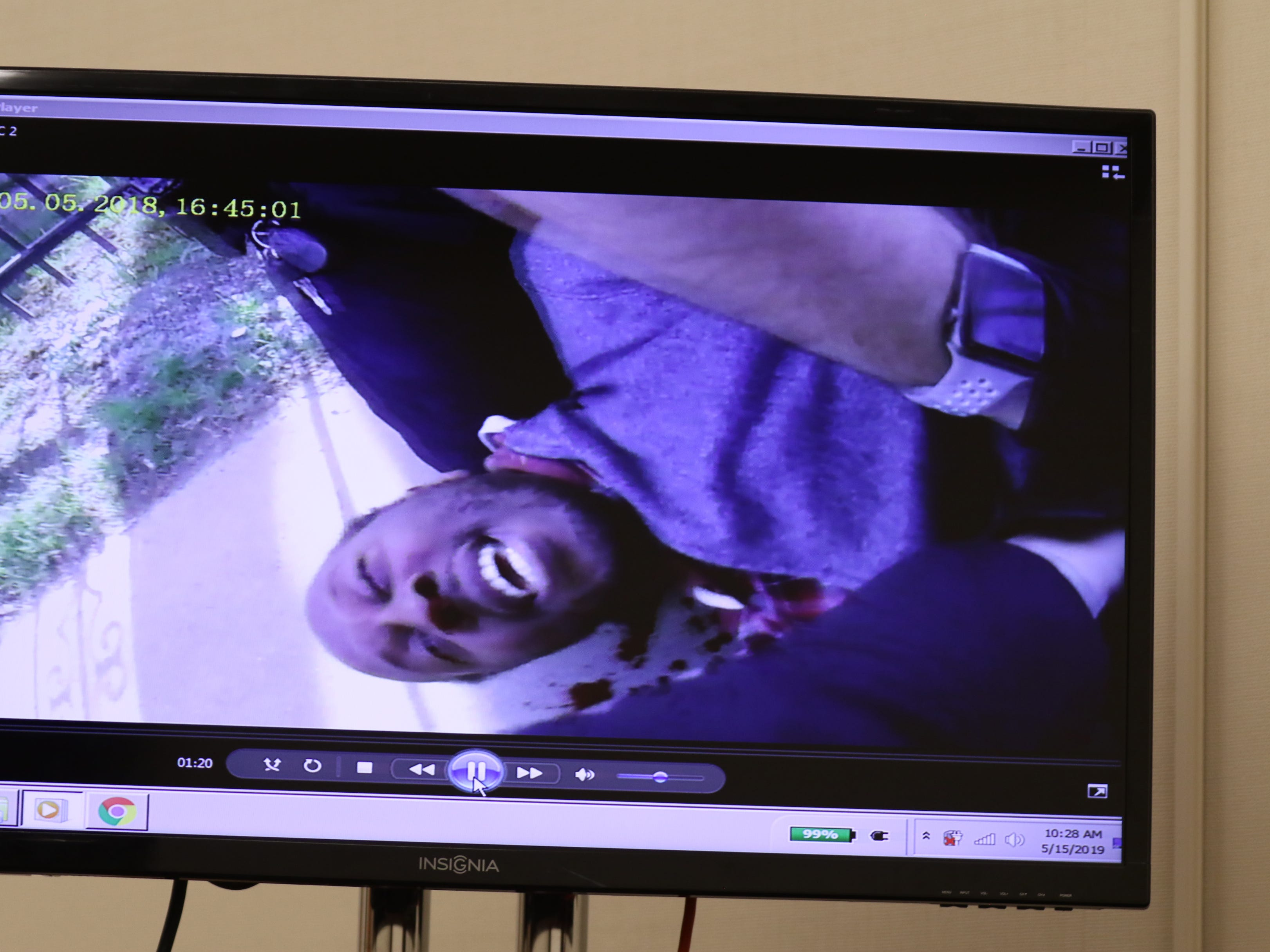 A screengrab showing Christopher Pate on the ground with blood beside his head.