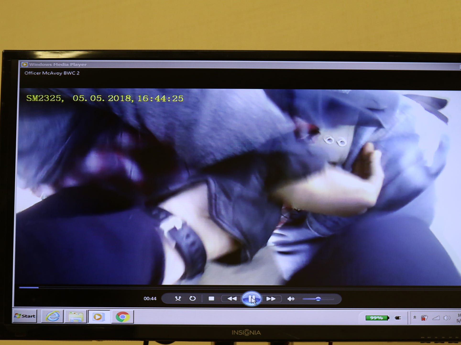 A screengrab of body camera video showing one of the police officers grabbing a hold of Christopher Pate's wrist.