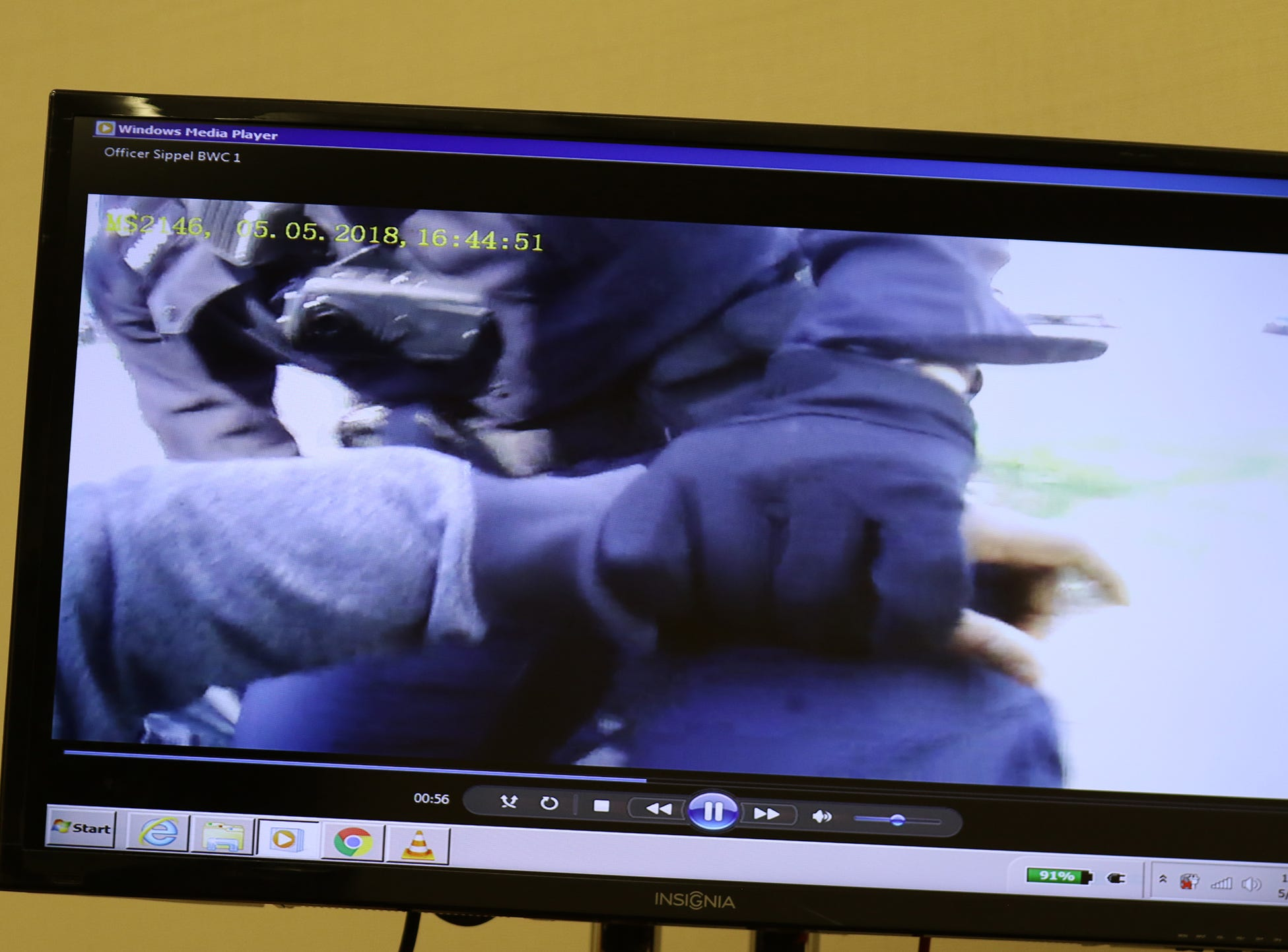 Body camera footage from Police Officer Michael Sippel showing Officer Spenser McAvoy having a grip on Christopher Pate's wrist and hand.