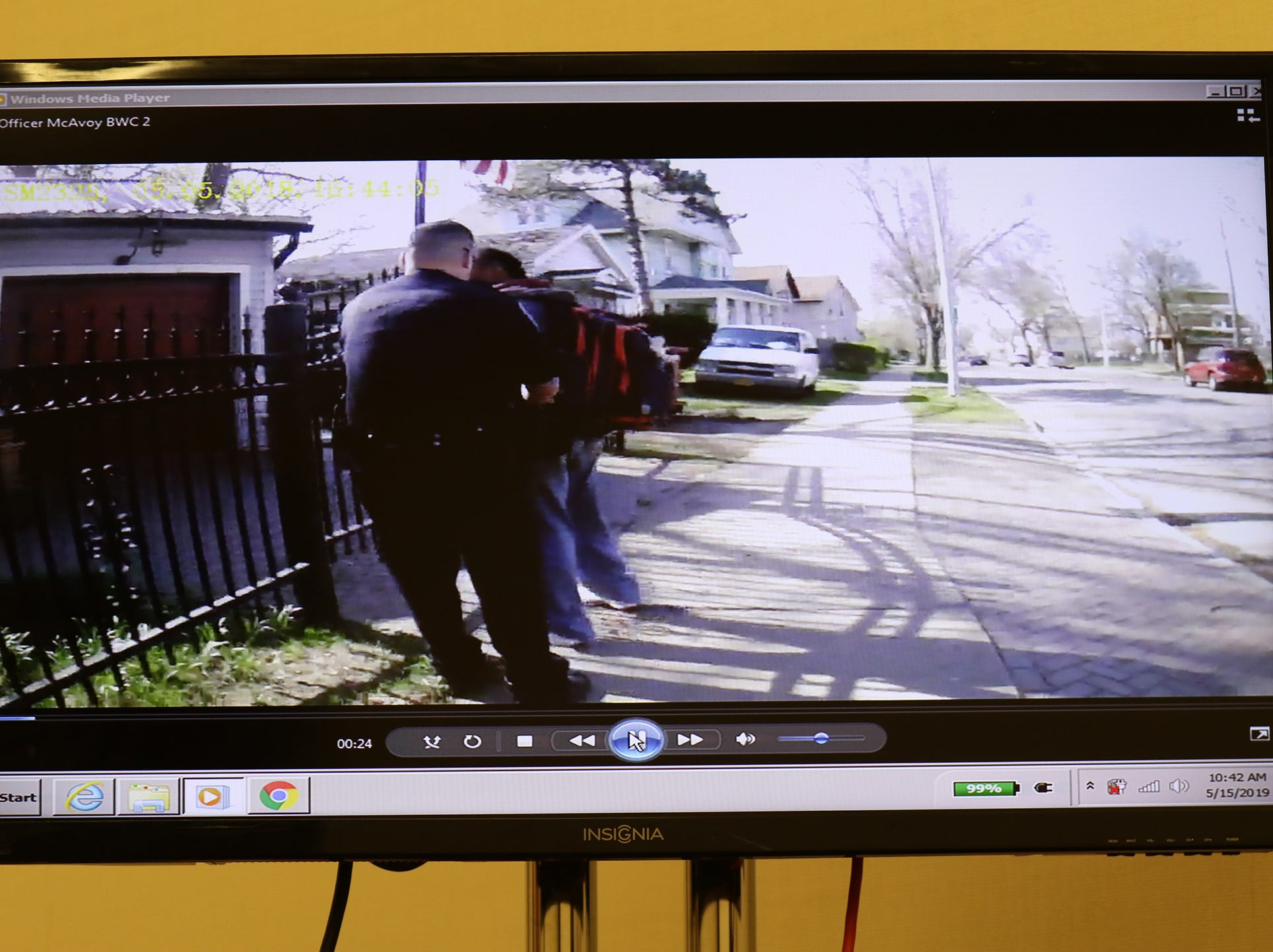 A screengrab of Officer Michael Sippel catching up with Christopher Pate and trying to grab a hold of his hands.