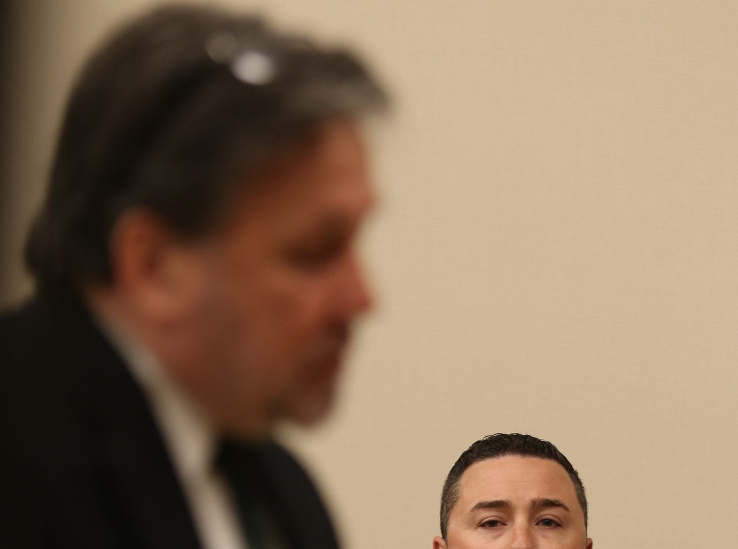 Rochester Police Officer Michael Sippel listens to his attorney, Clark Zimmermann, deliver the defense's opening statement.