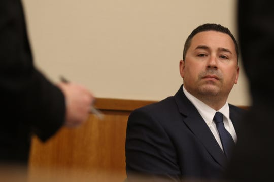 Rochester Police Officer Michael Sippel listens as defense attorney Clark Zimmerman objects to the playing of a certain portion of the body camera video.