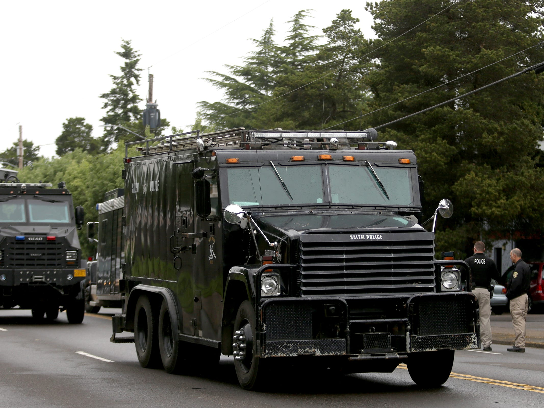 Salem Police clear the area after a suspect was taken into custody at an apartment on Broadway St. NE following an overnight officer-involved shooting in Salem on May 15, 2019. Following a traffic stop on Tuesday evening, a veteran Salem Police patrol officer was wounded by multiple gunshots. She has since been released from Salem Hospital. Police also took another person into custody who was in the apartment.
