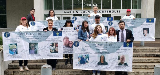 Family members and friends of Logan and Jessica Wilson gather outside the courthouse.