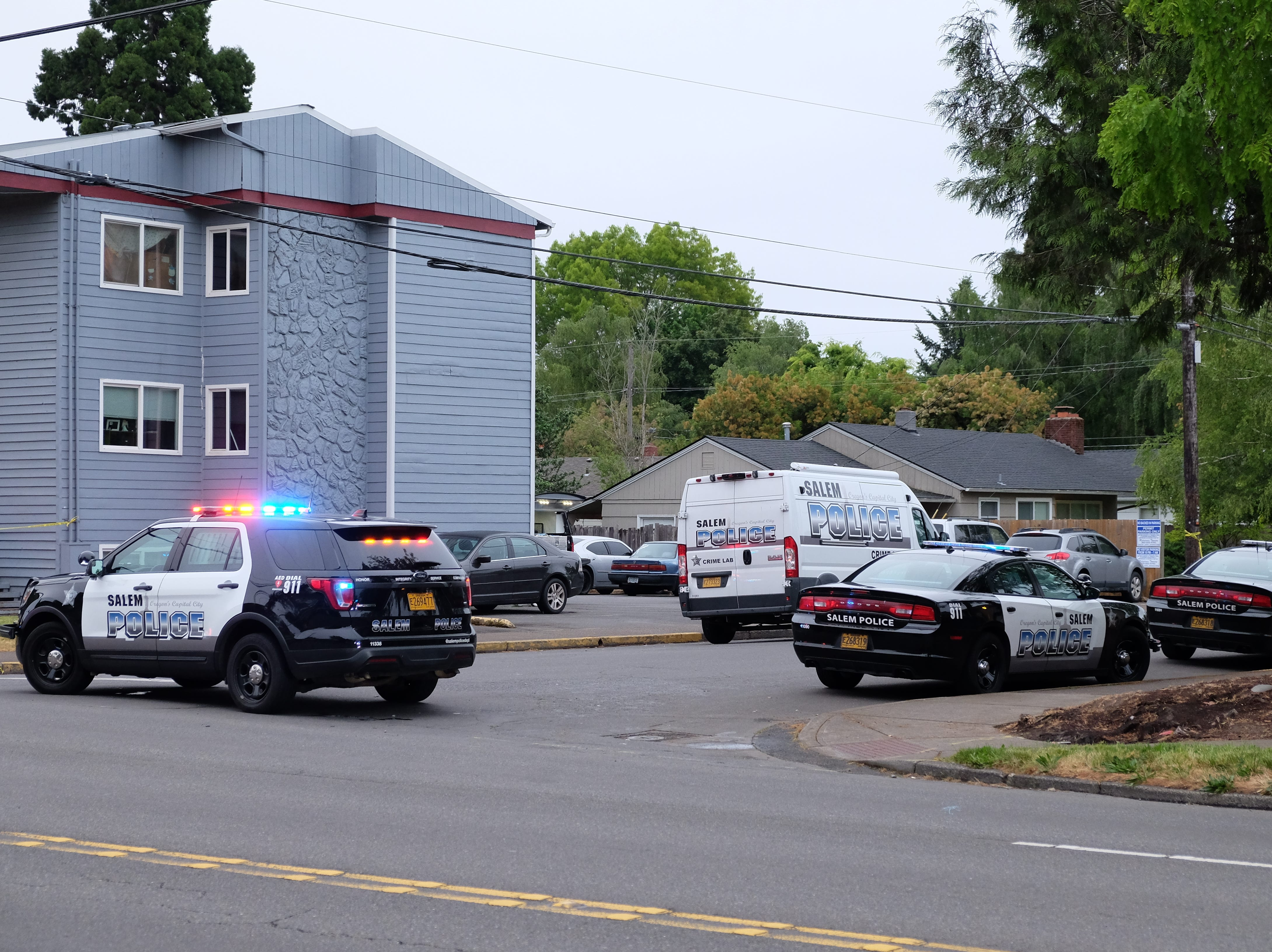 Police vehicles outside of an apartment complex in the 2500 block of Broadway where a suspect was taken into custody Wednesday morning, May 15, 2019.