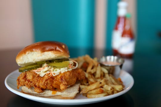 The Hot 'Bird' Sandwich with fries at Noble Wave Restaurant and Brewery in downtown Salem on May 13, 2019. The Cajun, Creole and southern food restaurant and bar will open, starting with limited hours, on May 15.