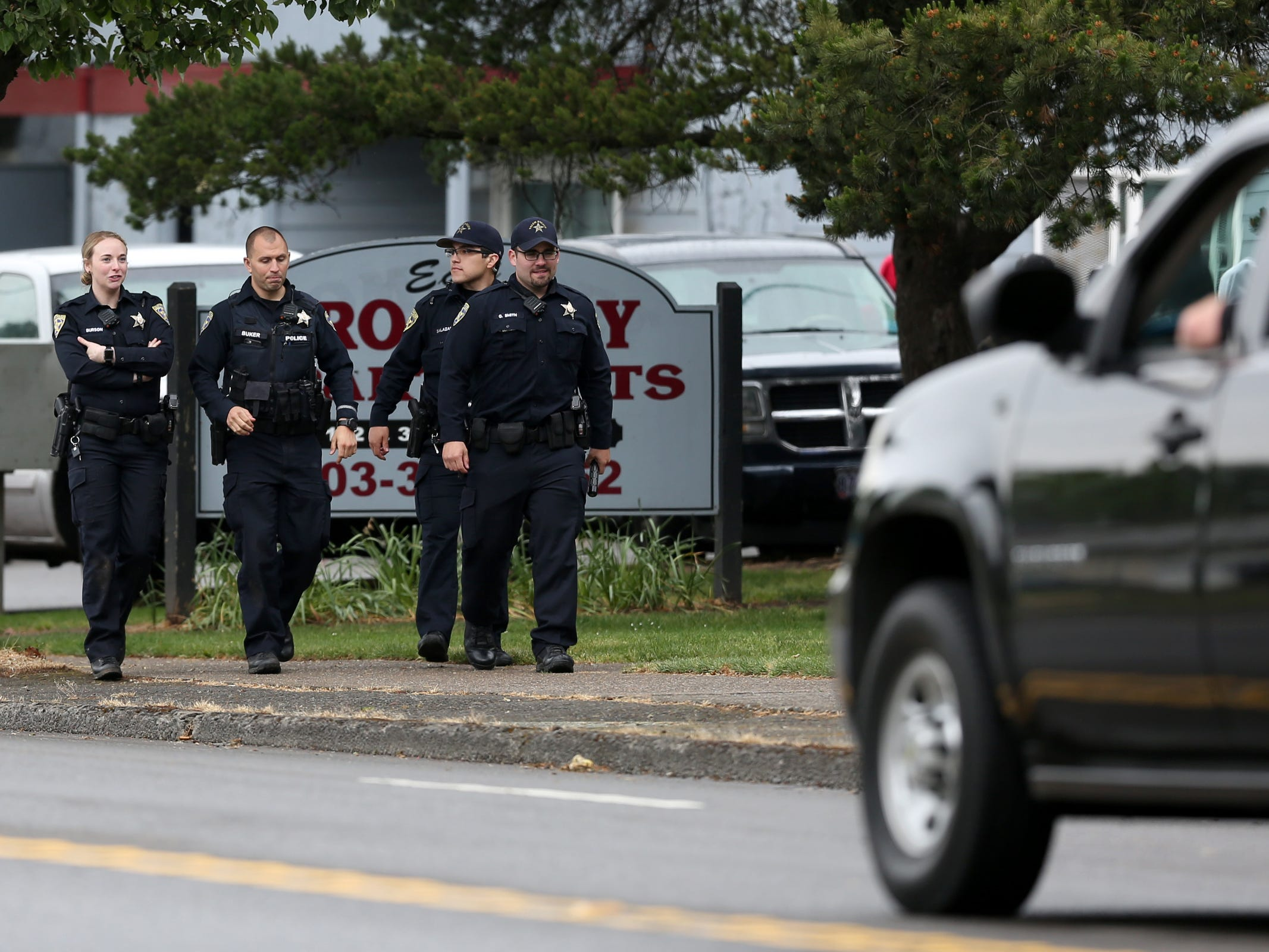 Salem Police respond to an apartment where a suspect in an overnight officer-involved shooting was hiding out on Broadway St. NE in Salem on May 15, 2019. Following a traffic stop on Tuesday evening, a veteran Salem Police patrol officer was wounded by multiple gunshots. She has since been released from Salem Hospital. Police also took another person into custody who was in the apartment.