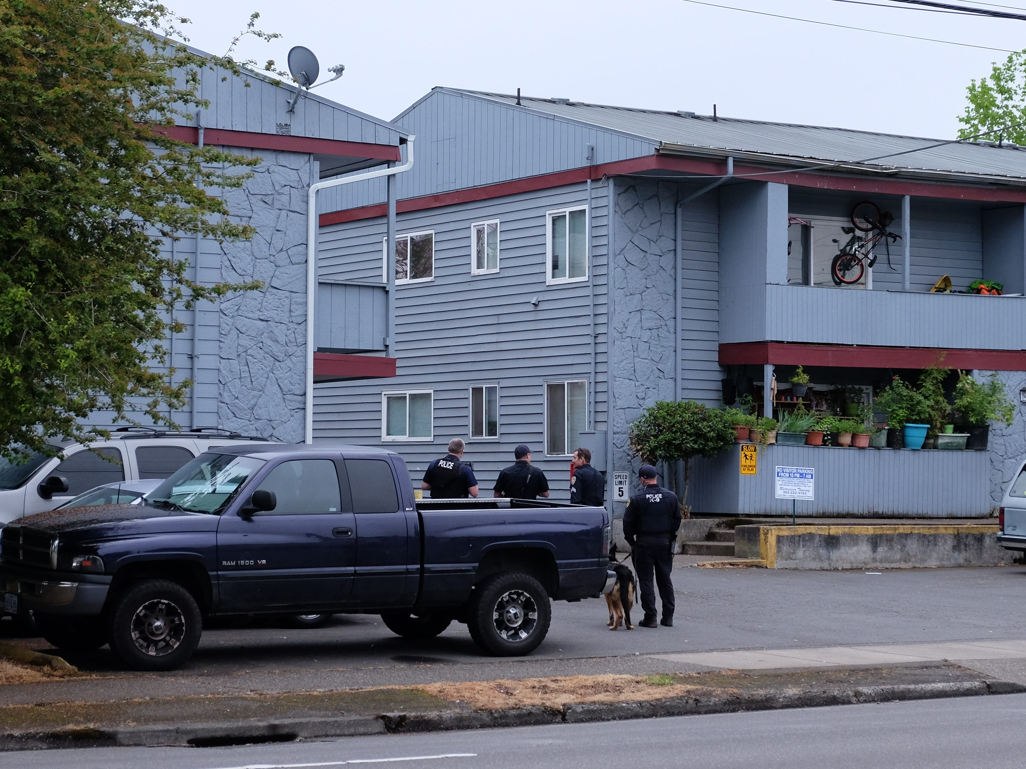 Officers outside of an apartment complex in the 2500 block of Broadway where a suspect was taken into custody Wednesday morning, May 15, 2019.