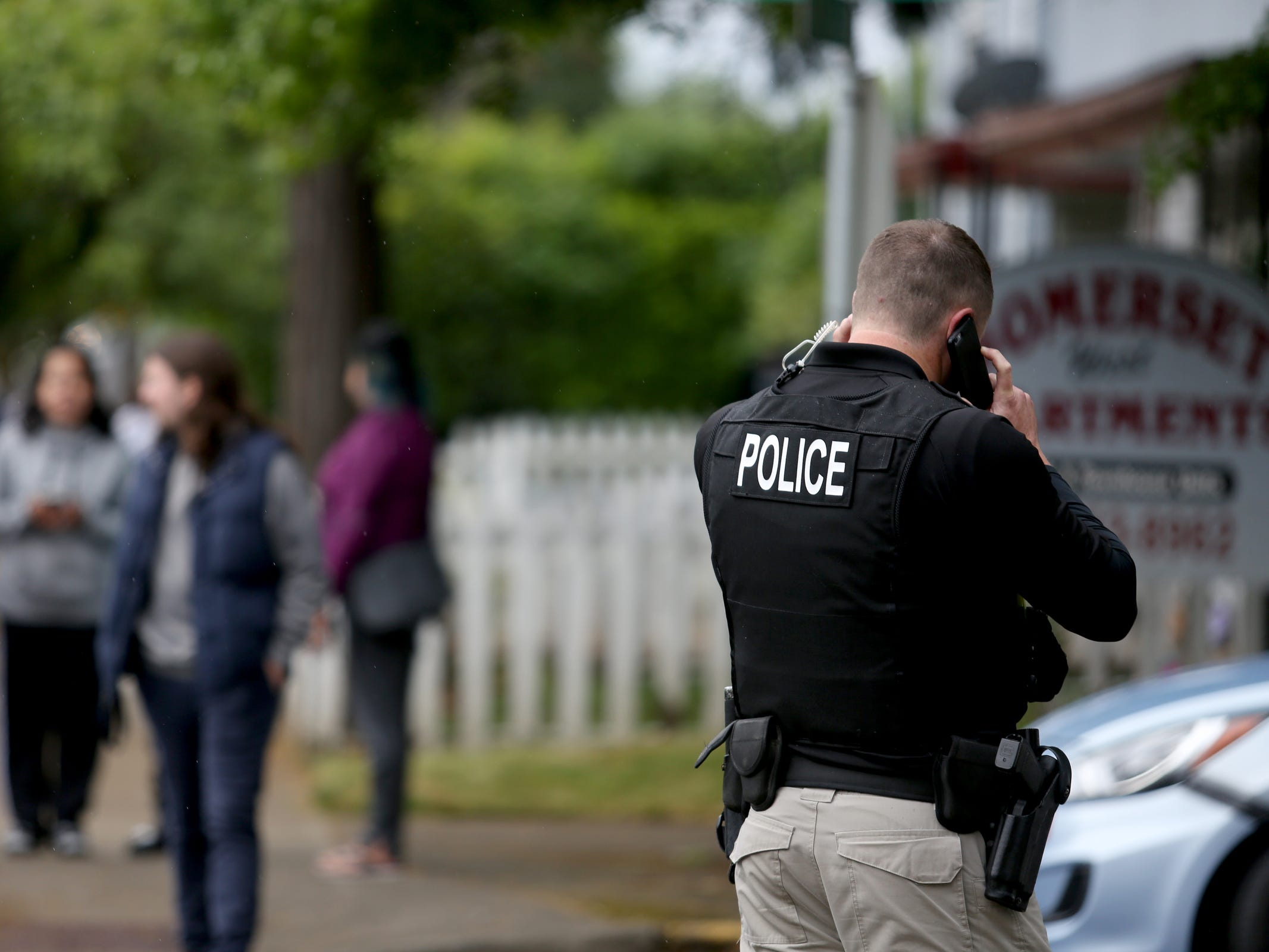 Salem Police Lt. Treven Upkes gets updated information after police responded to an apartment where a suspect in an overnight officer-involved shooting was hiding out on Broadway St. NE in Salem on May 15, 2019. Following a traffic stop on Tuesday evening, a veteran Salem Police patrol officer was wounded by multiple gunshots. She has since been released from Salem Hospital. Police also took another person into custody who was in the apartment.
