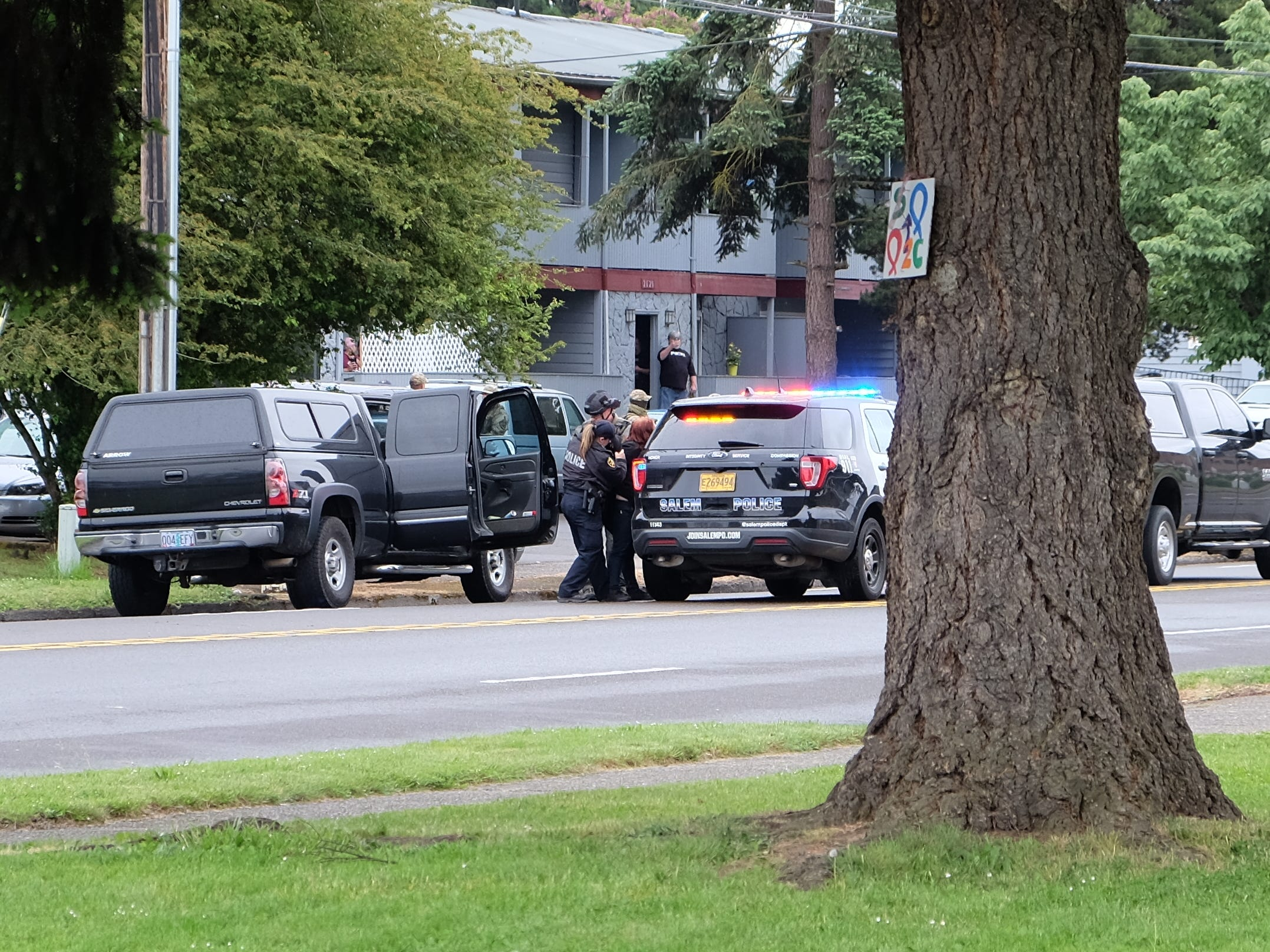 A woman is taken away in a Salem Police SUV outside of an apartment complex in the 2500 block of Broadway Wednesday morning, May 15, 2019.