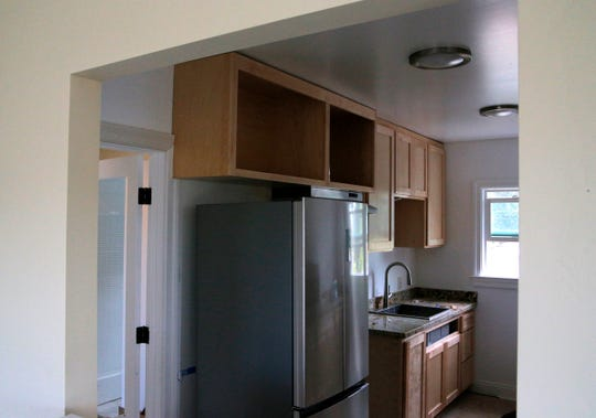 The kitchen of a rental property on Archer Street has been remodeled since a fire last year. The property owner, Carol Blum, of Santa Cruz, says the city billed her for $4,777.50 for abatement after a fire damaged the upstairs floor.