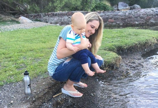 "Tara Borofka holds her son,  JT. ""He loves water. The sound of it, even,"" she said."