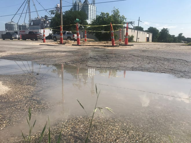 Water leaks out of a main break on Martin Luther King Drive and 3rd Street Tuesday, May 14, 2019.