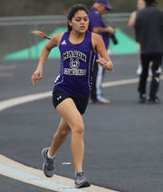Mason High School sophomore Ana Segura competes in the 1600 meters during the 2019 season. She broke the Mason school record in the event at regional then broke it again with her second-place finish at the UIL State Track and Field Championships May 11, 2019, in Austin.