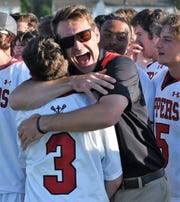 James M. Bennett assistant coach Will Calpino hugs Cayden Adkins after the Clippers defeated Mt. Hebron in the 3A East Regional Championship on Wednesday, May 15, 2019.