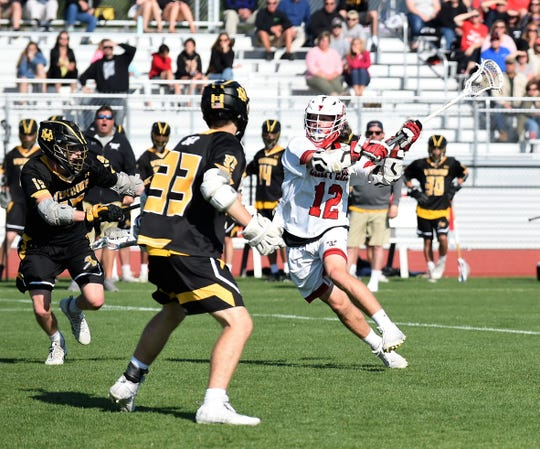 James M. Bennett midfielder Alex Sewell goes for a shot in the 3A East Regional Championship on Wednesday, May 15, 2019.