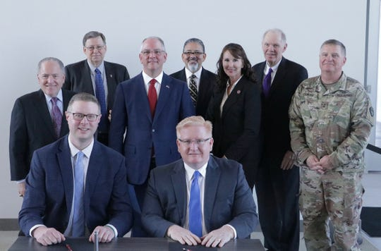 Third row (left to right): Louisiana T;ech President Les Guice; Grambling State President Rick Gallot; and LSU-Shreveport Chancellor Larry Clark.   Second row (l to r): LED Secretary Don Pierson; Gov. John Bel Edwards; Northwestern State's Darlene Williams; and Louisiana National Guard Maj. Gen. Glenn Curtis.   First row (l to r): Cybint Solutions Inc., CEO Bryan Dickens and Bossier Parish Community College Chancellor Rick Bateman.