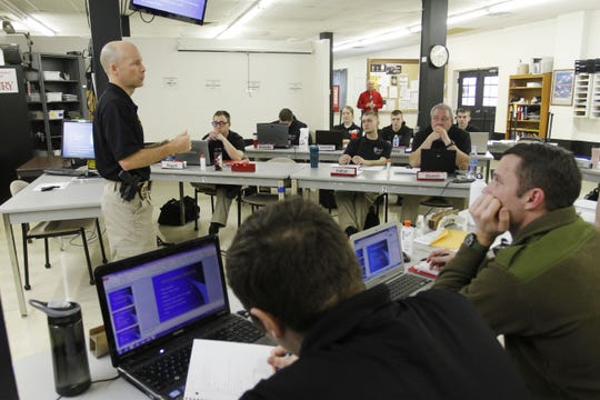 In 2015, Flint Roufs teaches a class at Drury's Law Enforcement Academy.