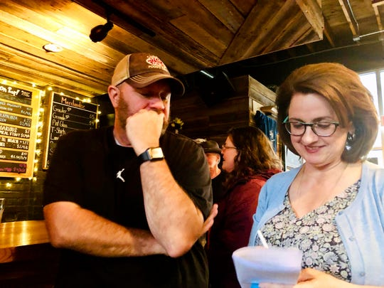 Jarrett Hatcher talks with Dawn Davis Womack before his comedy set at Restless Moons Brewing in Harrisonburg on April 25.
