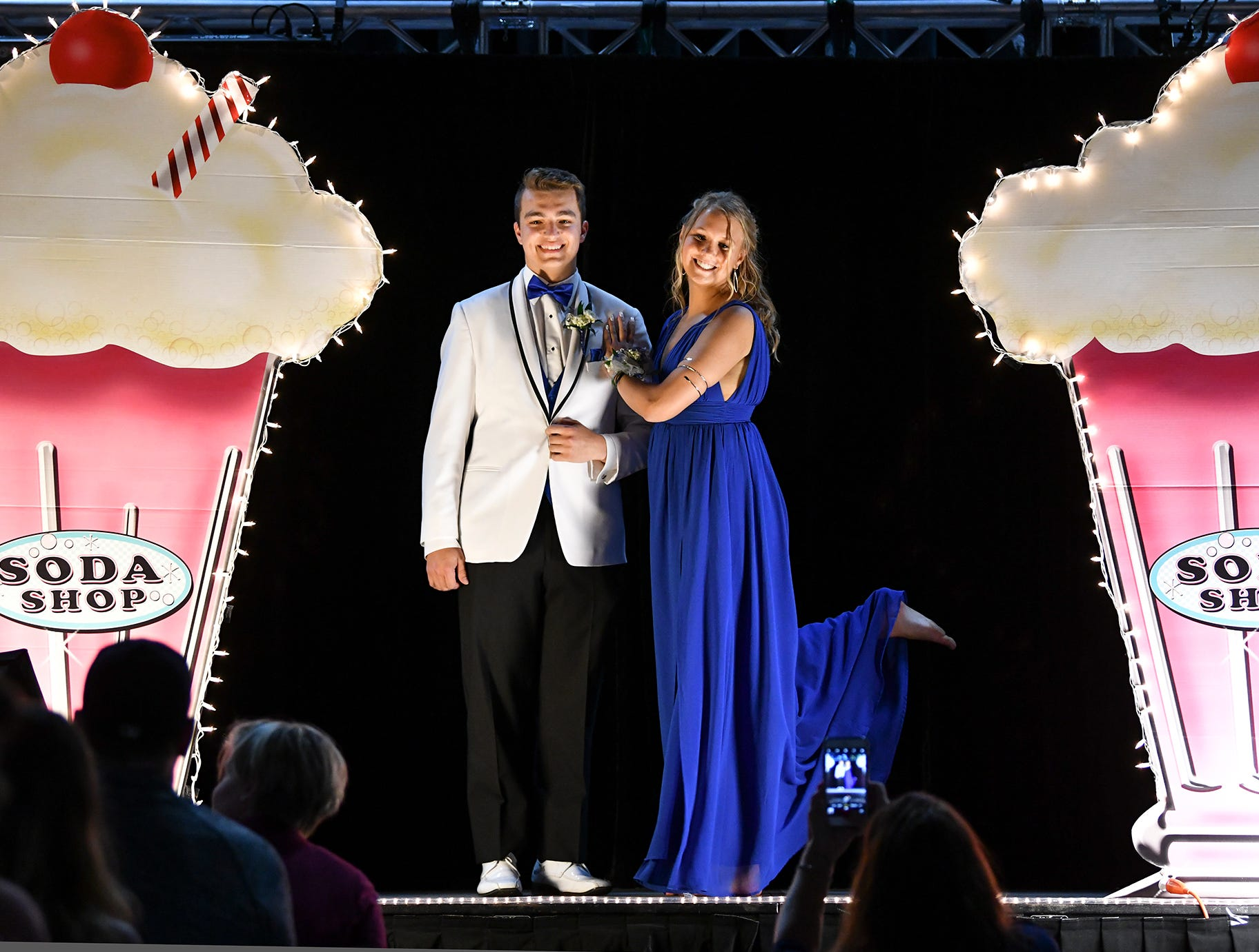 A couple strikes a pose on the grand march route during Sartell High School's prom Saturday, May 4, at the River's Edge Convention Center in St. Cloud.