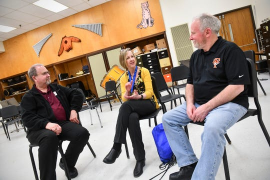 Retiring high school music directors Scott Campbell, Dianne Brady and Gary Zwack talk about their careers during an interview Tuesday, May 7, in St. Cloud.