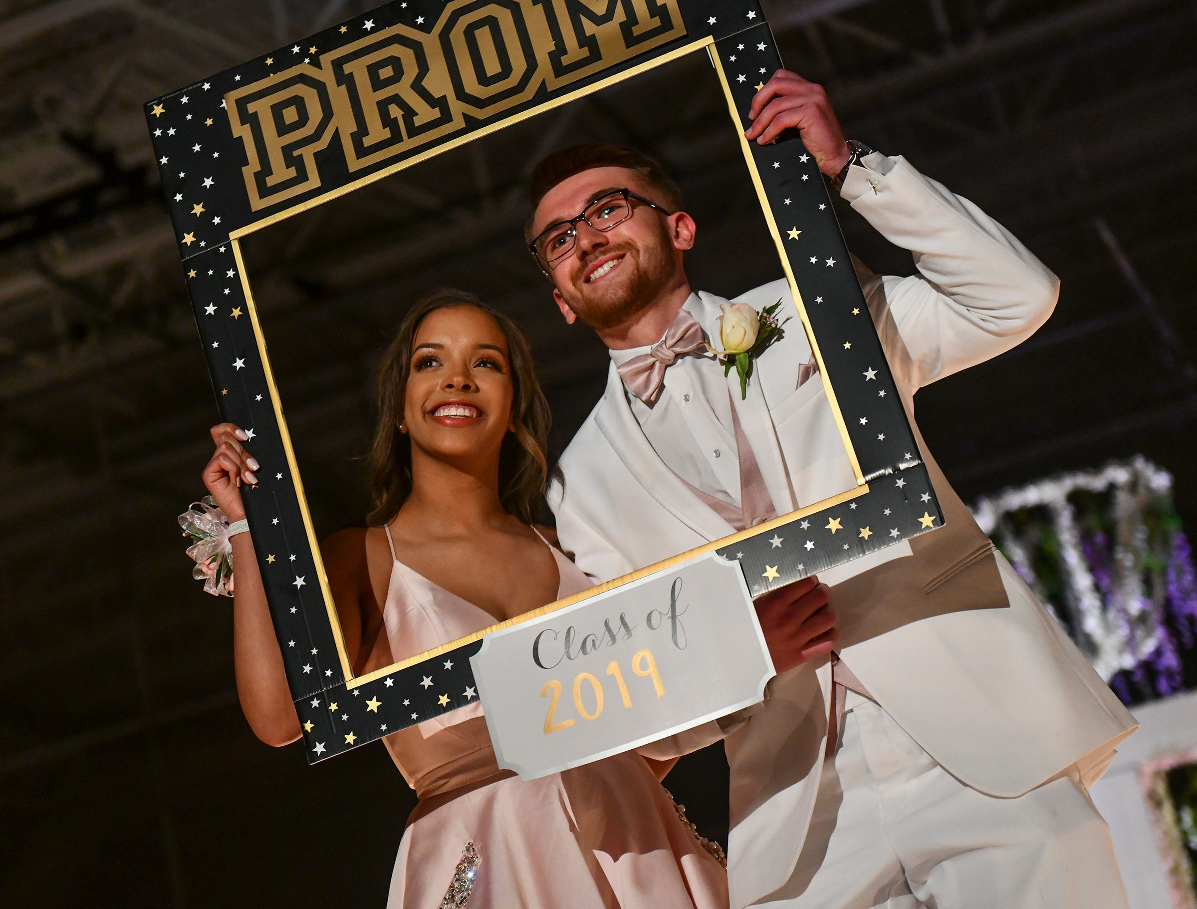A couple uses a frame prom during their turn at prom grand march Saturday, May 11, at Sauk Rapids-Rice High School.