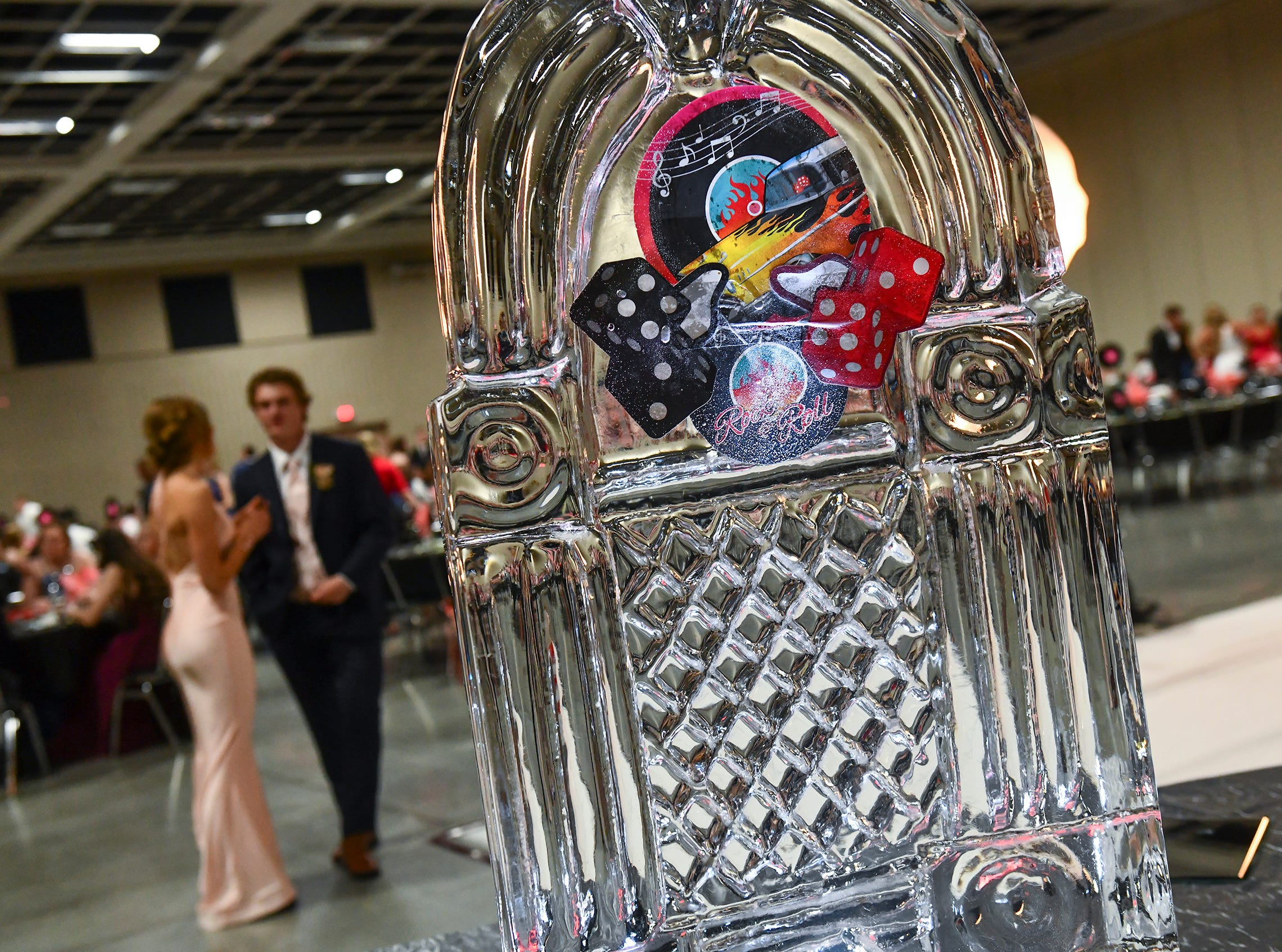 An ice sculpture reflects the 1950s theme during Sartell High School prom Saturday, May 4, in St. Cloud.