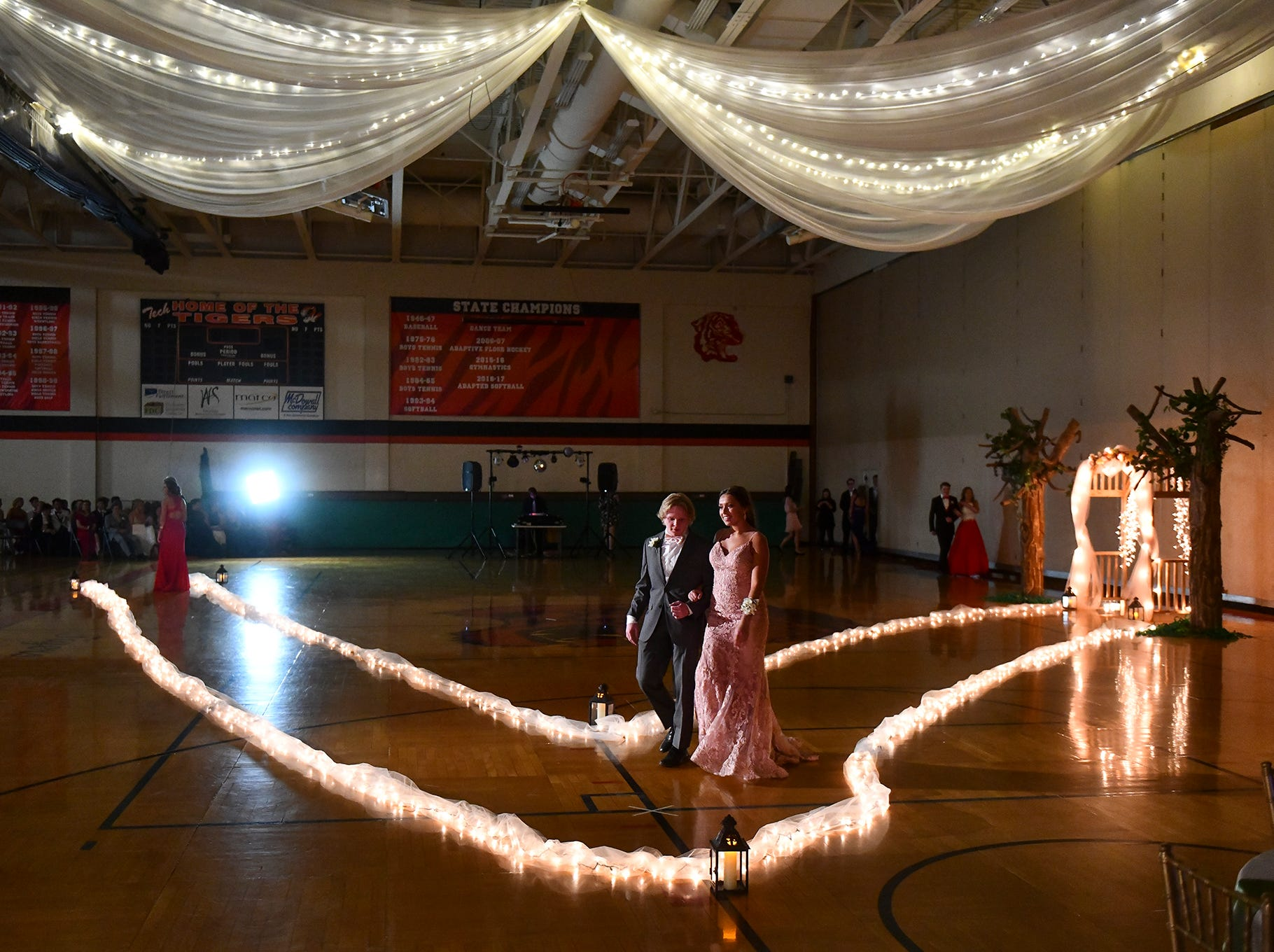 Couples take part in prom grand march Saturday, April 27, in theTech High School gymnasium in St. Cloud.
