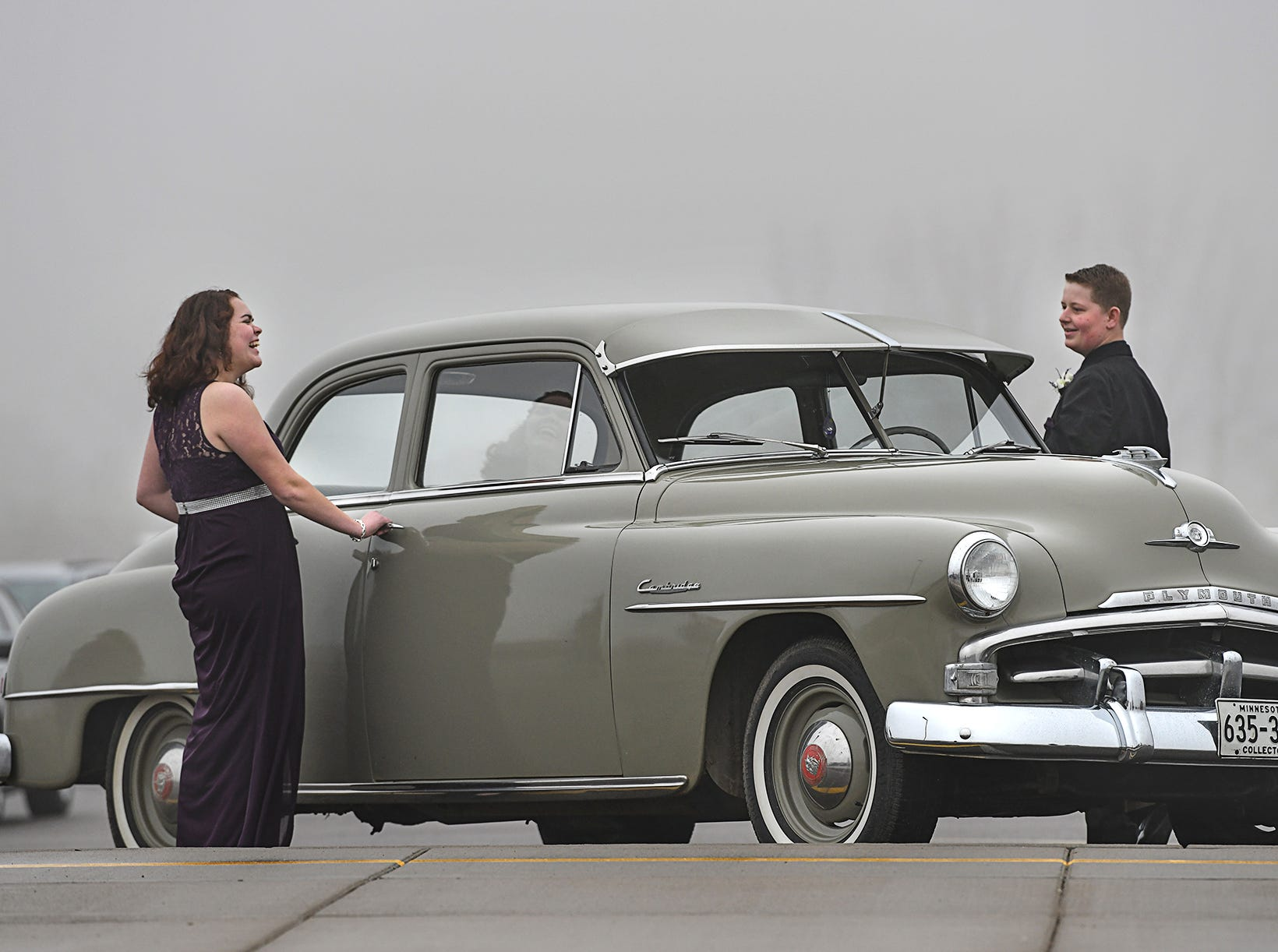 """Avery Kompelien and Nicole Pachan get ready to leave in a vintage 1952 Plymouth after taking their turn in the prom grand march Saturday, April 6, at Albany High School. This year's Albany prom theme was """"The Great Gatsby."""" For more photos go to www.sctimes.com."""