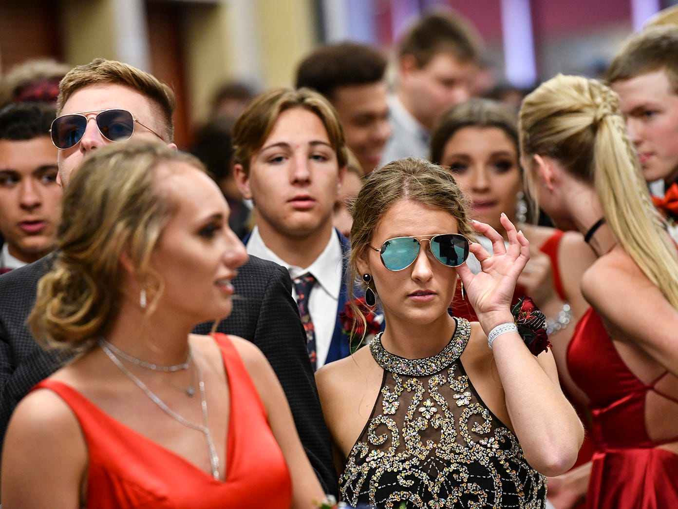 Tristan Lewellyn gets ready to take her turn at the prom grand march with her date Brock Leither Saturday, April 13, at ROCORI High School in Cold Spring.