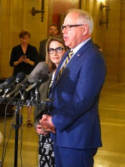 Democratic Minnesota Gov. Tim Walz, right, accompanied by Lt. Gov. Peggy Flanagan, left, speaks with reporters during a break in budget talks at the state Capitol in St. Paul, Minn., Tuesday, May 14.