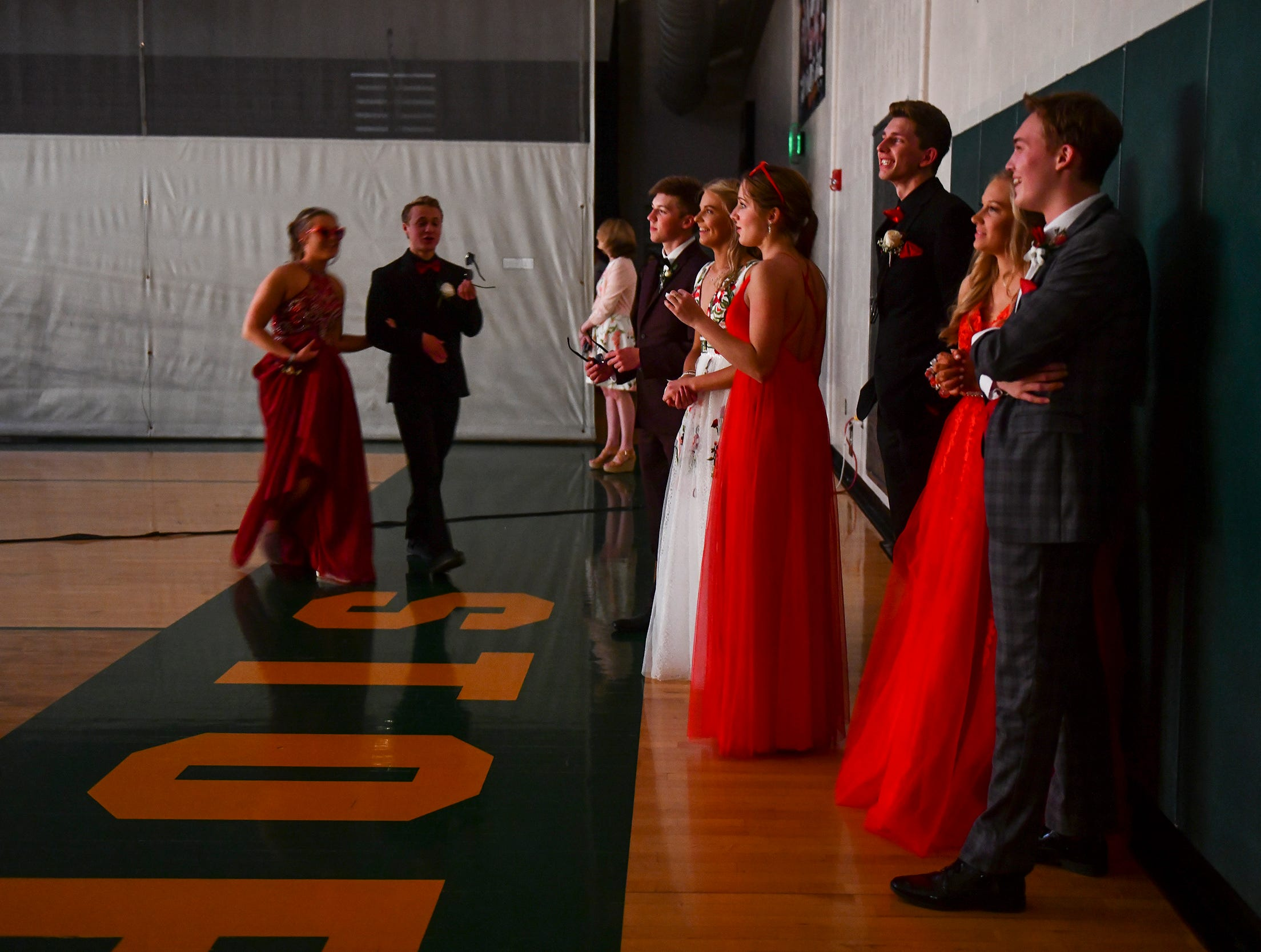 Couples watch their classmates during prom grand march Saturday, May 11, at Sauk Rapids-Rice High School.
