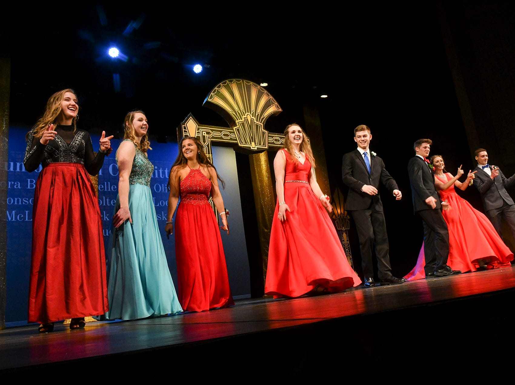 Junior prom committee members take the stage at the end of grand march Saturday, April 6, at Albany High School.