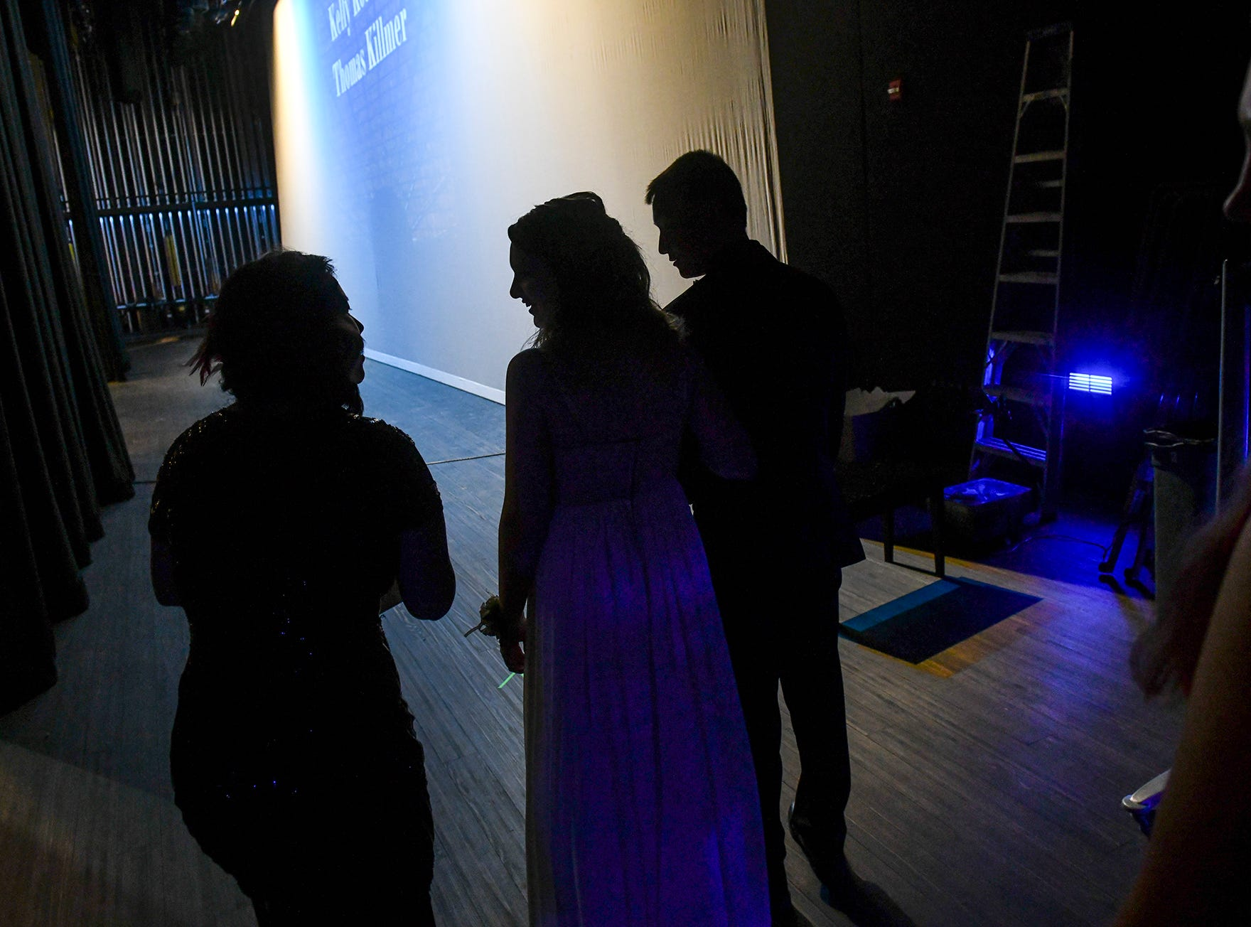 Couples get ready for their turn on stage during prom grand march Saturday, April 6, at Albany High School.