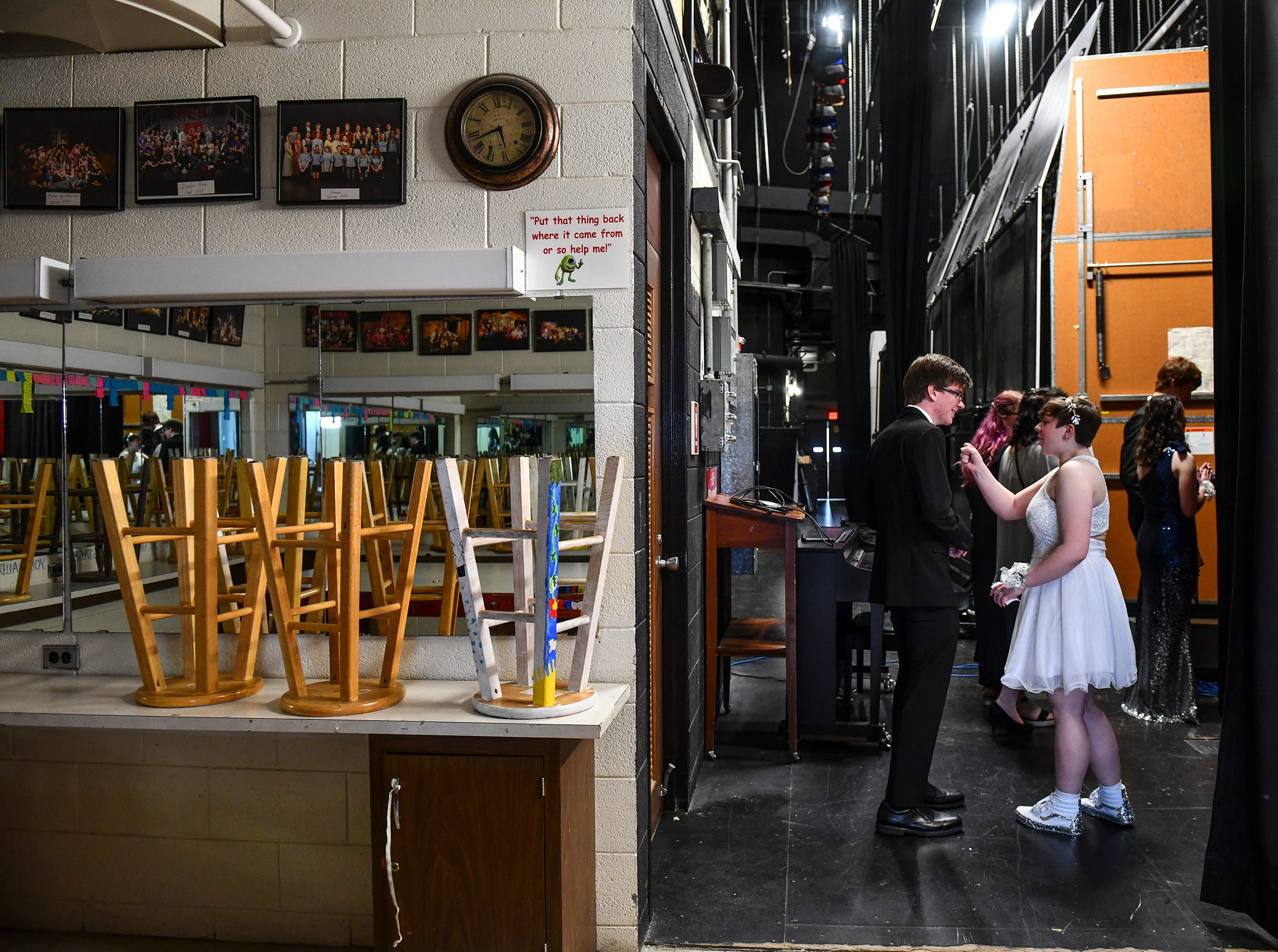 Couples get ready backstage for their turn at prom grand march Saturday, May 11, at Apollo High School in St. Cloud.