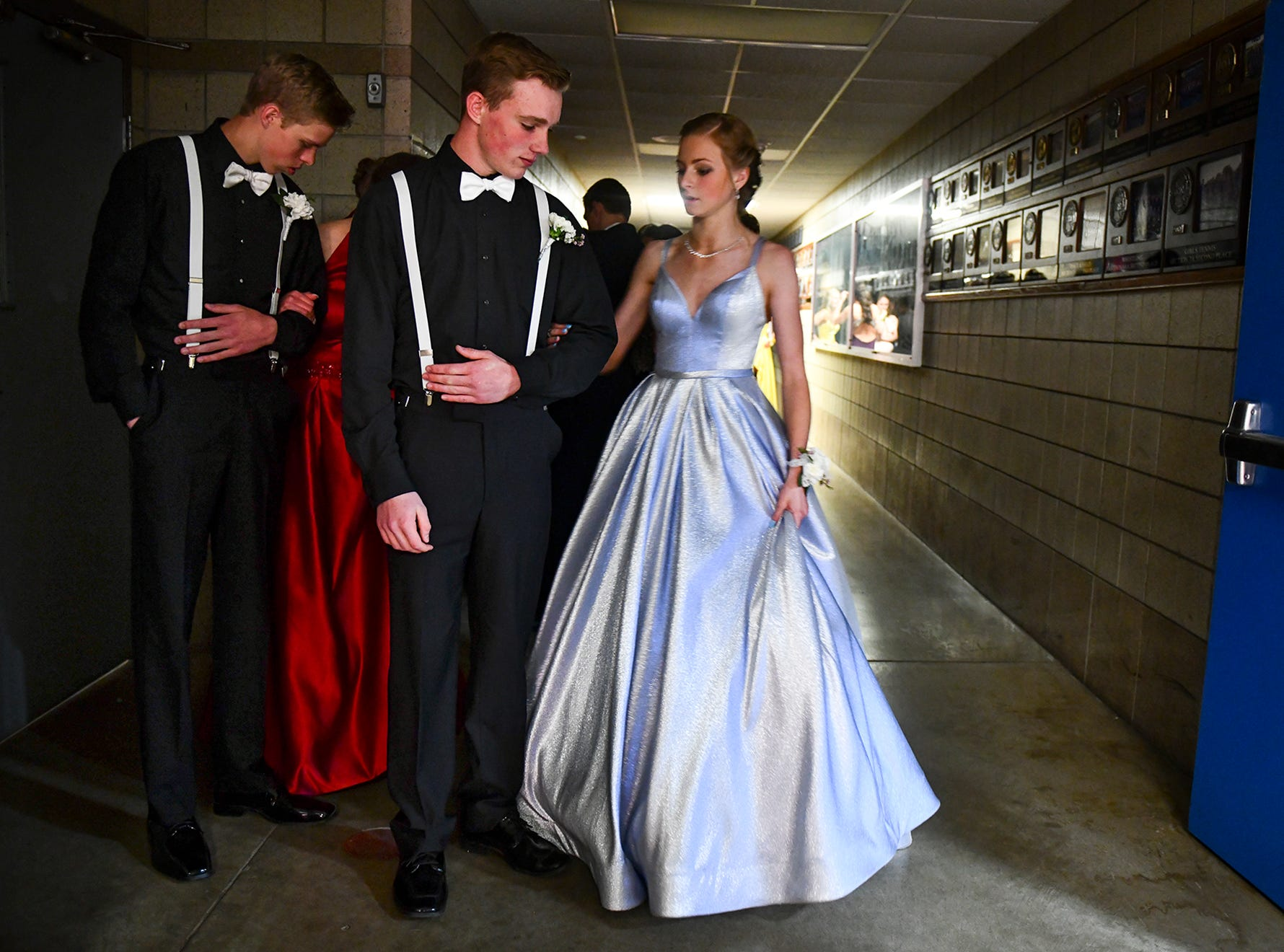 """Samantha Lewandowski and Wyatt Harris get ready to take their turn to lead off the prom grand march route Saturday, April 27, at Foley High School. The theme of this year's prom was """"Bright Lights, Big City."""""""