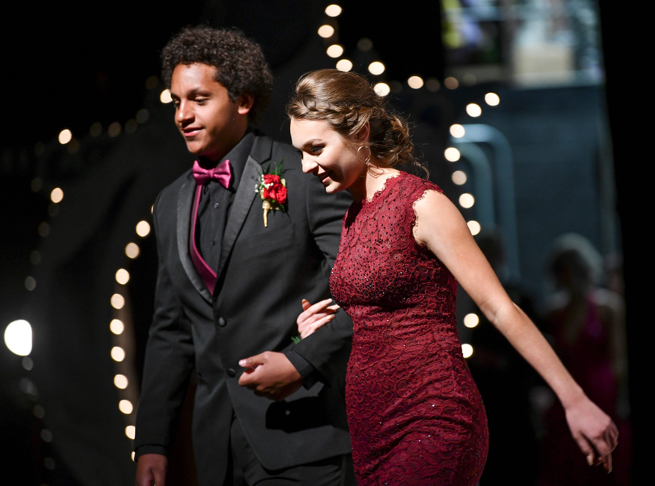 A couple makes their way off stage after taking part in prom grand march Saturday, May 11, at Apollo High School in St. Cloud.