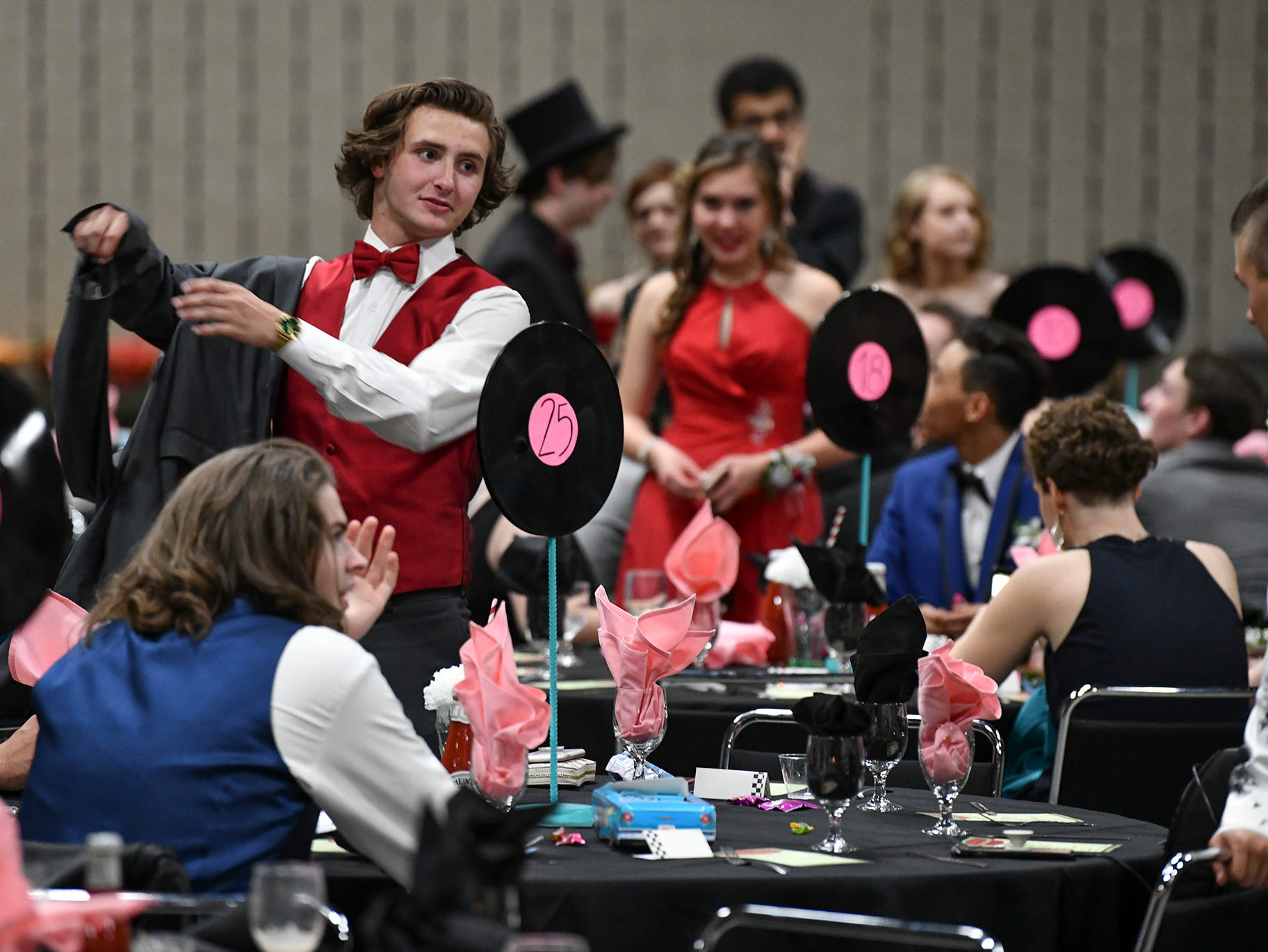 Students gather at 50s-themed tables during Sartell High School's prom Saturday, May 4, at the River's Edge Convention Center in St. Cloud.