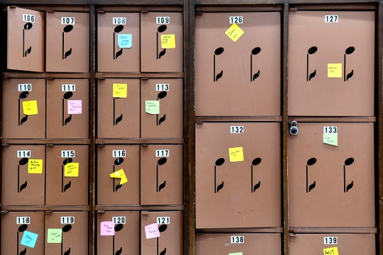 Instrument lockers are highlighted with note cutouts in the Technical High School band room.