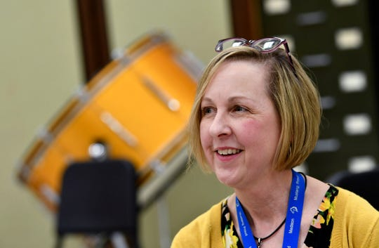 Apollo High School orchestra director Dianne Brady smiles while talking about her students during an interview Tuesday, May 7, in St. Cloud.