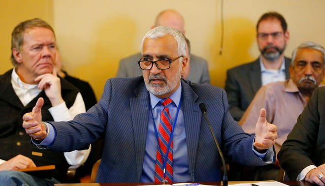 FILE - In this Feb. 21, 2019 file photo, Salt Lake County District Attorney Sim Gill speaks to the members of the Senate Judiciary, Law Enforcement, and Criminal Justice Standing Committee at the Utah State Capitol, in Salt Lake City. Gill, the chief prosecutor in the county with Utah's only two abortion clinics says he won't enforce a new law banning most of the procedures after 18 weeks.  (AP Photo/Rick Bowmer, File)