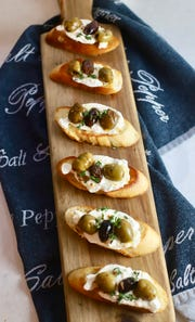 Bruschetta with Citrus Roasted Olives and Burrata can be served as an appetizer or a light lunch or dinner.
