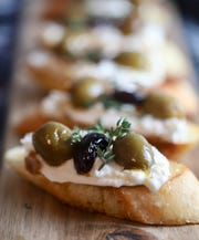 Bruschetta with Citrus Roasted Olives and Burrata, toasted in a skillet with butter.