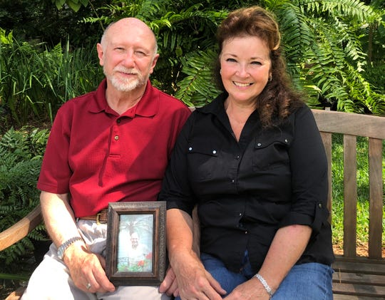 Kathryn Brenner and her husband Robert Beadling with a photograph of her father, the late David Brenner.
